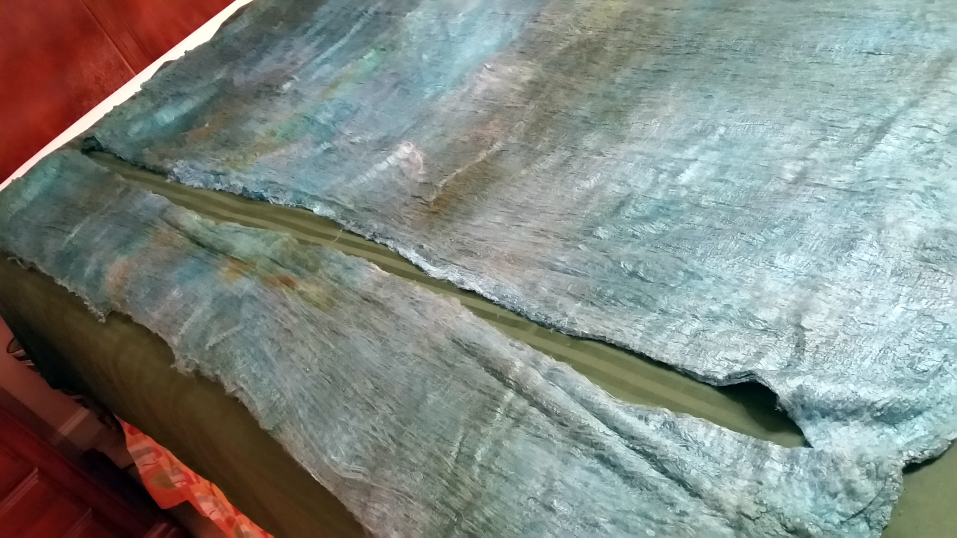 The Silk Lap, a strip cut off