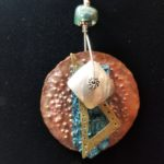 Silver, Copper, and Brass Stacked Spinner Pendant
