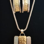 Silver and Brass Pendant and Earrings